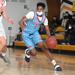 Nahseer Johnson dribbles a basketball