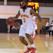 Darnell Artis dribbles a basketball
