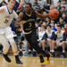 Zane Martin dribbles a basketball