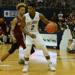 Kris Jenkins dribbles a basketball