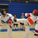Two women sparring in adult martial art classes