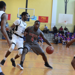 An Imhotep player drives to the basket as Mastery North players guard him