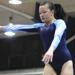 Downers South's Emily Tom leaps on balance beam
