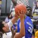 Proviso East's Isaac Moore goes for the block against Hinsdale South's Barret Benson