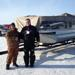 Meadow Terence Grams of Lloydminster, the grand prize and bonus prize winner of the Jackfish Lake Ice Fishing Derby is congradulated by Battlefords North Stars president Darren Huxley infront of Grams new pontoon boat.