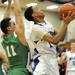 Riverside-Brookfield's Daniko Jackson gets fouled by Ridgewood's Anthony Mroz
