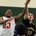 Elmwood Park's Tom Hap defends North Chicago's Jamero Shelton