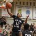 Maine East's Ezeka Omeke grabs a rebound