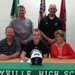 Grant Dix with his parents and baseball coach as he signs his letter of intent to play for Southwest Tennessee CC