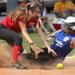 Norridge Harwood Heights' Claudia Maloberti (97) slides in safe