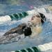 In this Nov. 22, 2013, photo, New Trier's Katy Christian competes in the 100-yard backstroke during the state swim meet prelims.