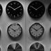Black and white image of several clocks