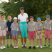Michelle Wie poses with a local PGA Junior League Golf team after being named an Ambassador