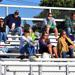 Football parents watching from the grandstand.
