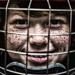 A young hockey player in a facemask