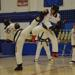 Two Taekwondo black belts sparring at a Denver, CO area martial arts tournament