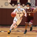Sam Davison dribbles a basketball