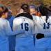 women's soccer team huddles before a game