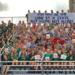 The Seneca sports teams gather at the stadium for photo with inspirational banner.