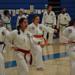 Four martial arts women doing a Taekwondo poomse