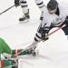 Bemidji High School junior Andrew Dondelinger (4) tries to free the puck after a faceoff in the second period against East Grand Forks Thursday at the Bemidji Community Arena. (Jillian Gandsey | Bemidji Pioneer)