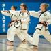 Teenagers practicing martial arts during lessons