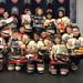 Squirt Minor team caps tournament championship with toy drive for less fortunate