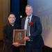 Matt Roggenburk '86 receives Athletic Hall of Fame award from Fr. Raymond P. Guiao S.J. '82.