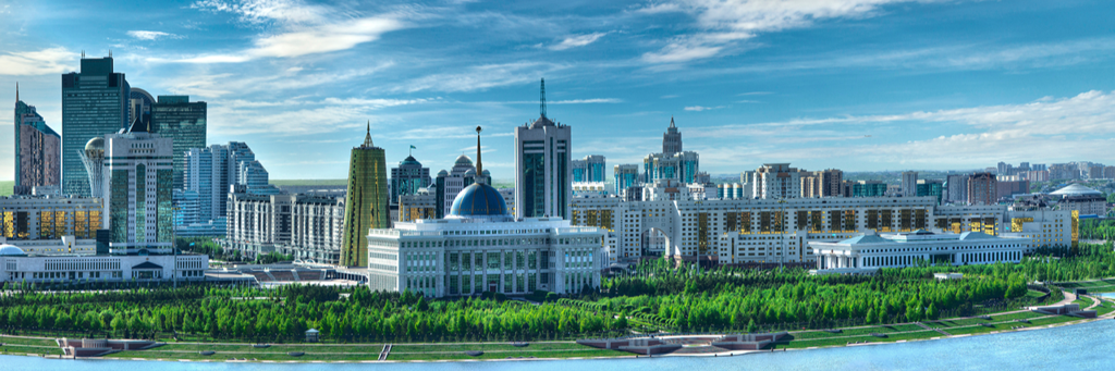 Skyline of Nur-Sultan in Kazakhstan with Golden Tower, Presidential Palace, Baiterek Tower and House of Ministries next to Ishim river