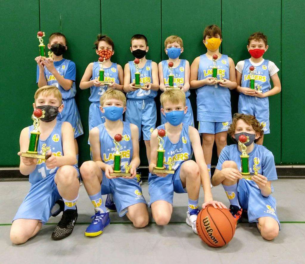 Mpls Lakers Youth Traveling Basketball Program Inc Boys 4th Grade Gold pose with their trophies after placing 2nd at the Edina Cake Eater Classic tournament in Edina, MN