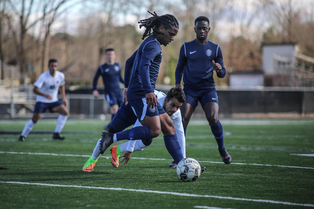 Duane Muckette dribbles the ball in a preseason match against Lyon College.