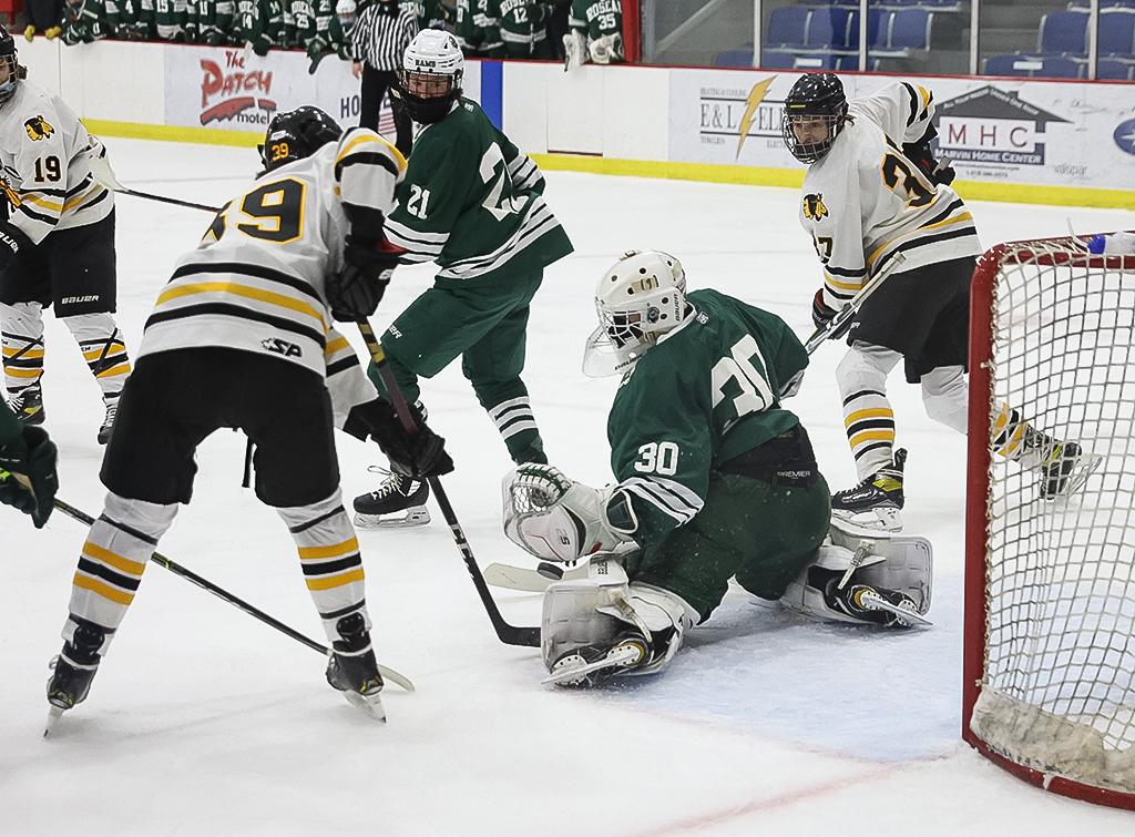 Roseau goaltender Andrew Tuttle makes a pad save in the first period. Tuttle returned to the lineup after missing three games due to quarantine helping the Rams to a 4-3 overtime win at Warroad on Thursday night. Photo by Cheryl A. Myers, SportsEngine