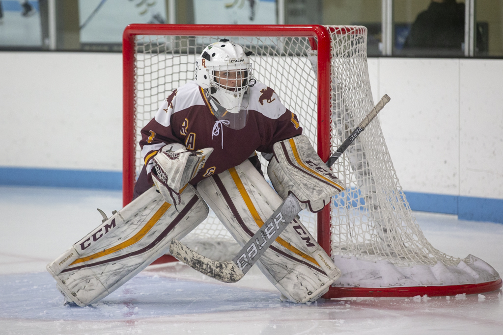 Forest Lake's Allyn Goehner watches the play in the corner against East Ridge. Goehner had 18 saves in the Rangers' 3-1 victory over the Raptors. Photo by Jeff Lawler, SportsEngine