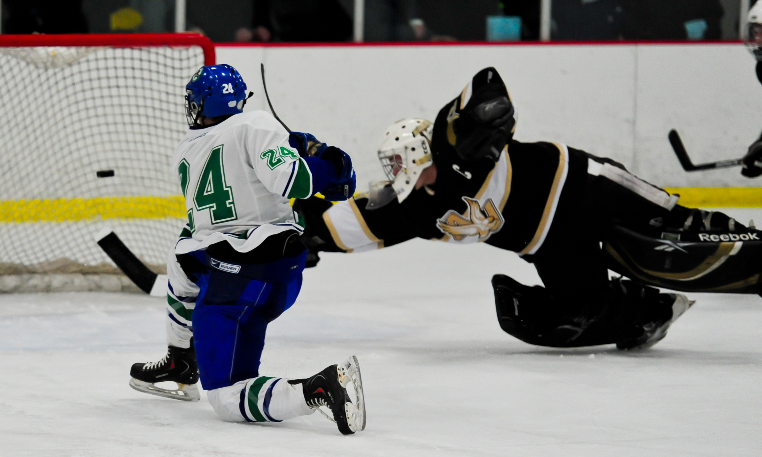 Eagan junior forward Will Merchant (No. 24) buries his game-winning goal  past Apple Valley goaltender Aaron Gretz in the second period of the  Thursday 056f8ad61