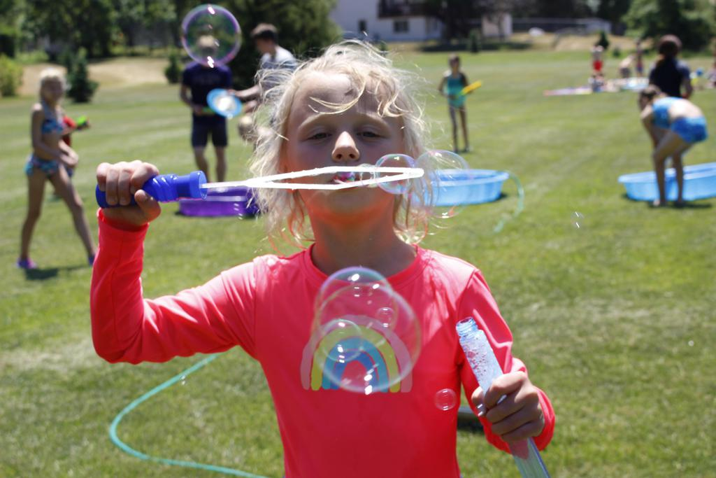 Student at summer camp with bubbles