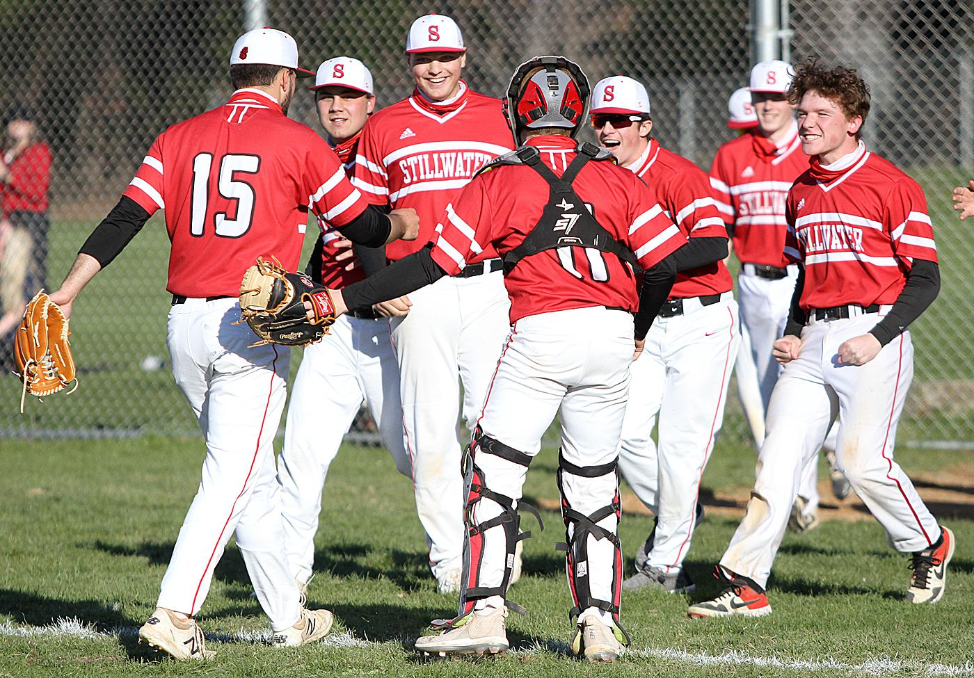 Teammates mob pitcher Stillwater pitcher Gavin Zurn following the Ponies' 1-0 defeat of Mounds View Wednesday in a Suburban East Conference matchup. Photo by Drew Herron, SportsEngine
