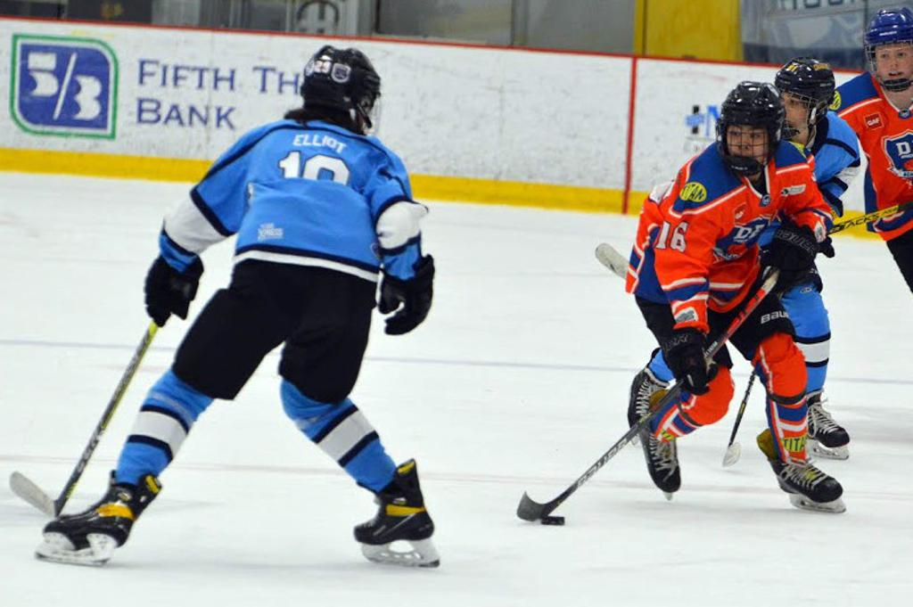 DB Hockey player carrying the puck