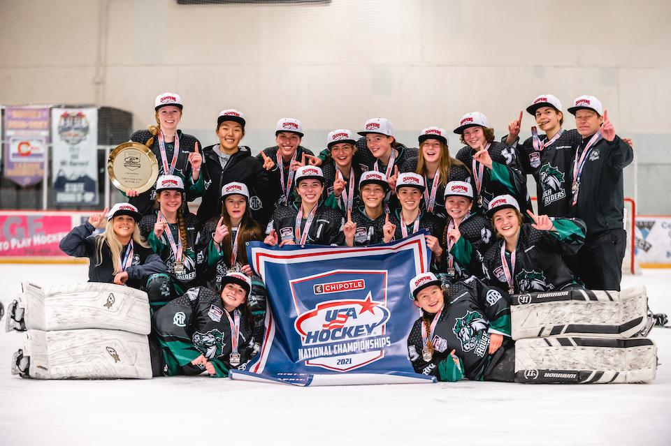 The Lady RoughRiders 16U team celebrated the organization's first USA Hockey national championship following a 3-2 OT victory on May 3. Photos courtesy of CAHA