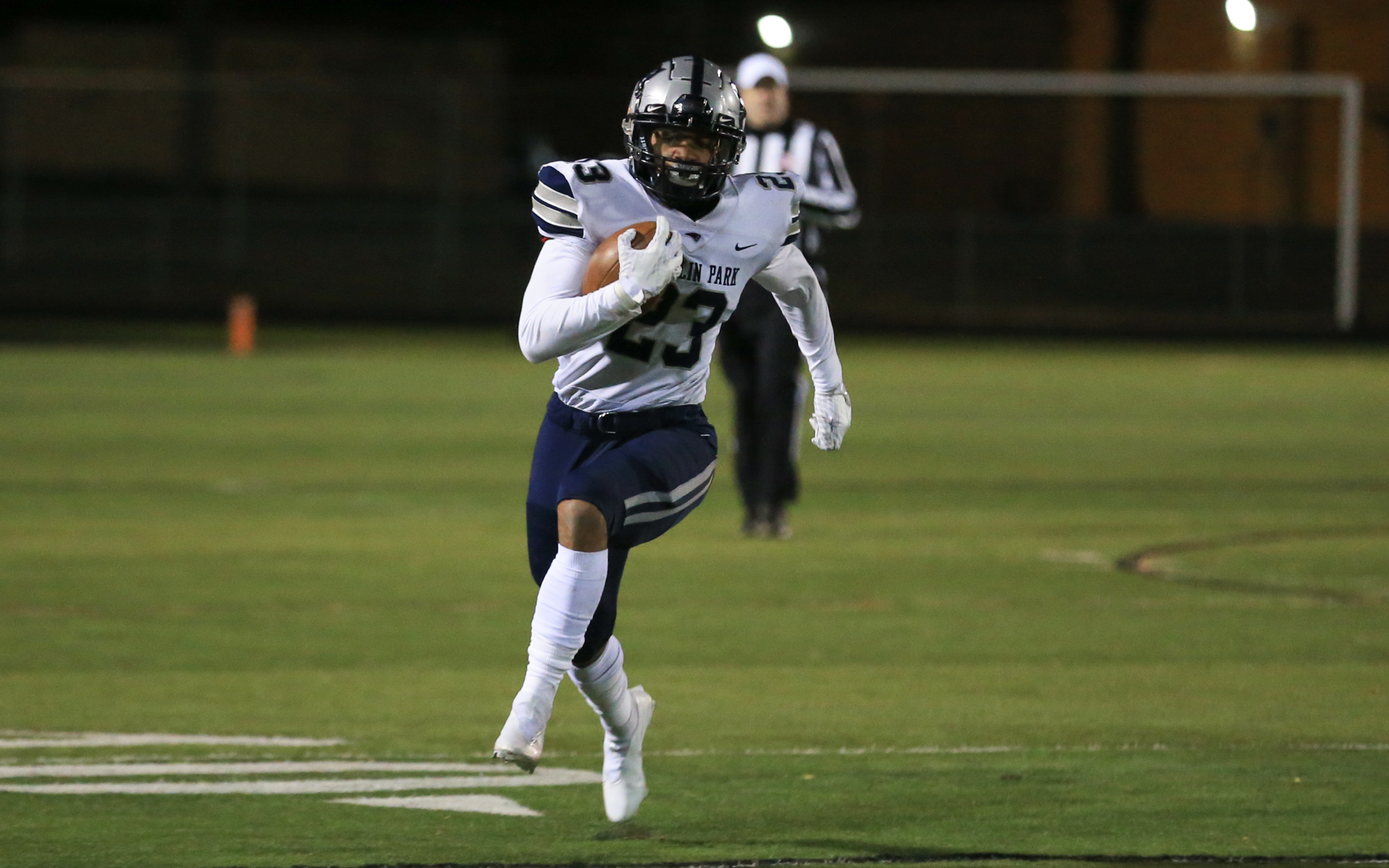 Champlin Park's Shawn Shipman (23) dashes down the sideline for a nice gain against Osseo Thursday night. Shipman scored on an 80-yard run in the first quarter during the Rebels' 14-7 victory over the Orioles in Osseo. Photo by Jeff Lawler, SportsEngine