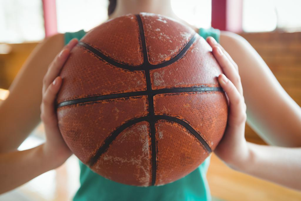 Girls holding basketball