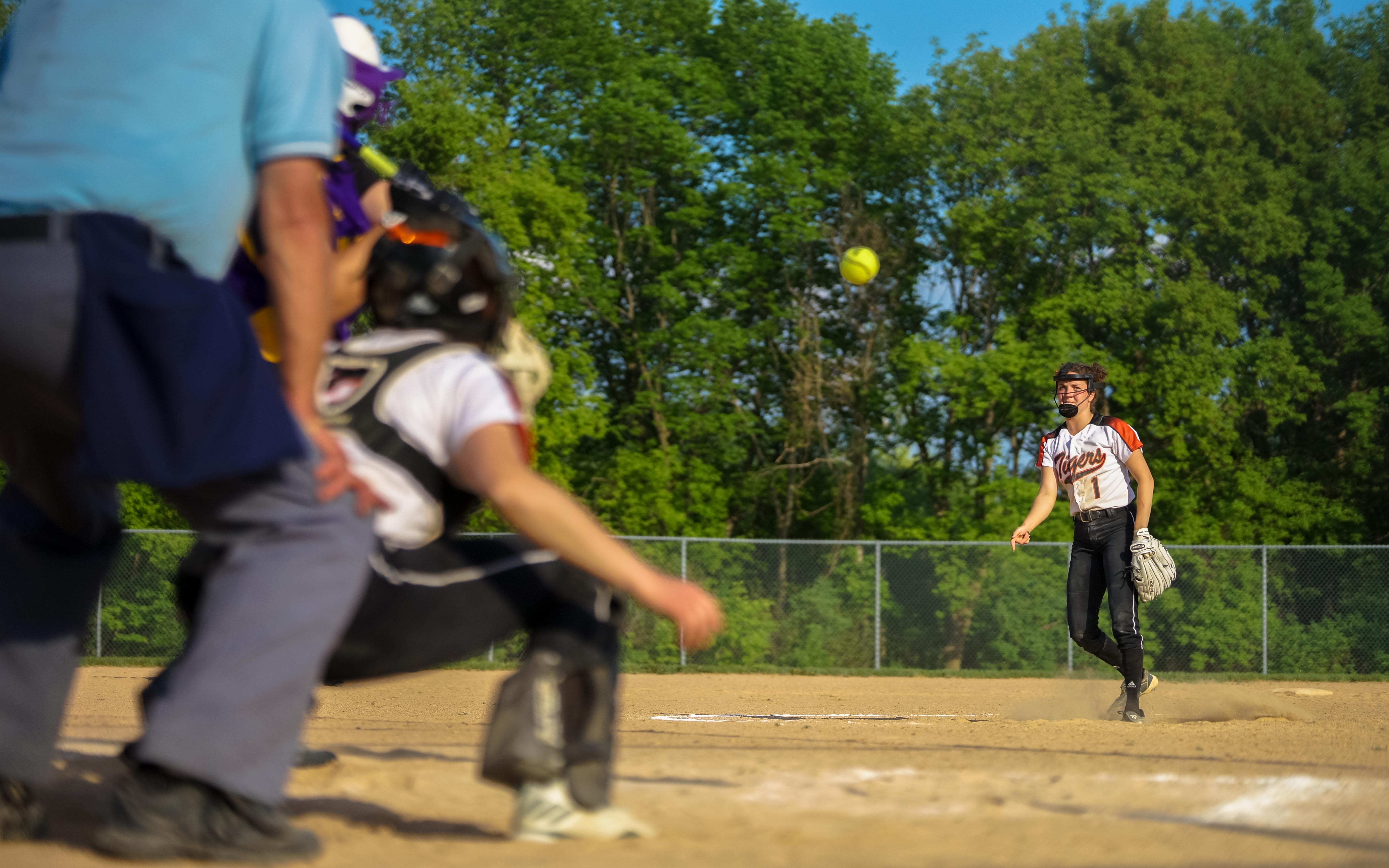 Delano pitcher Lauren York (1) delivers a pitch to a visiting Waconia batter Friday. York lead her team to a 3-1 victory, and helped with a key walk in a fourth-inning rally. Photo by Korey McDermott, SportsEngine