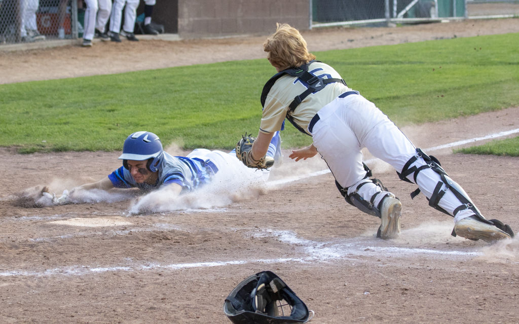 Heritage Christian Academy sophomore Jonny Flynn slides safely into home just ahead of the diving tag from Providence Academy's Kasner Sturm. The Eagles defeated the Lions 4-1 Friday at Arnold Klaers Field in Loretto. Photo by Jeff Lawler, SportsEngine