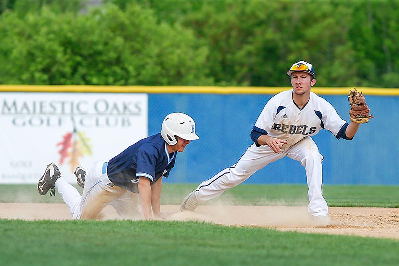 Blaine pinch runner Bryce Nelson slid safely into second ahead of the throw to Champlin Park shortstop Nick Bauer. Photo by Mark Hvidsten, SportsEngine