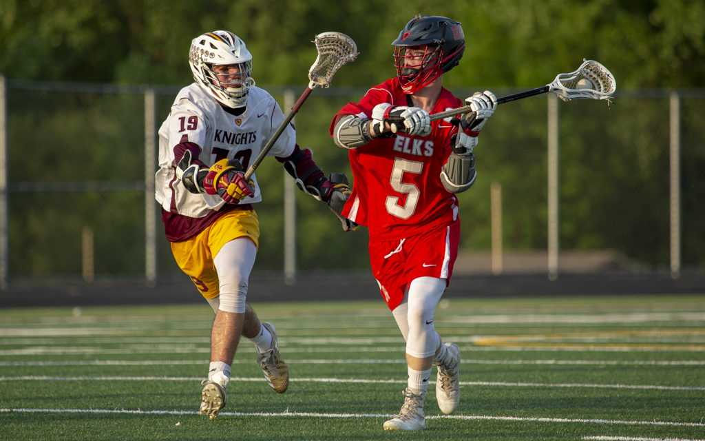 Elk River's Kyle Jussila looks for room to pass as Irondale's Griffin Bourassa defends. The Elks fell to the Knights 8-7 in overtime Wednesday night in New Brighton. Photo by Jeff Lawler, SportsEngine