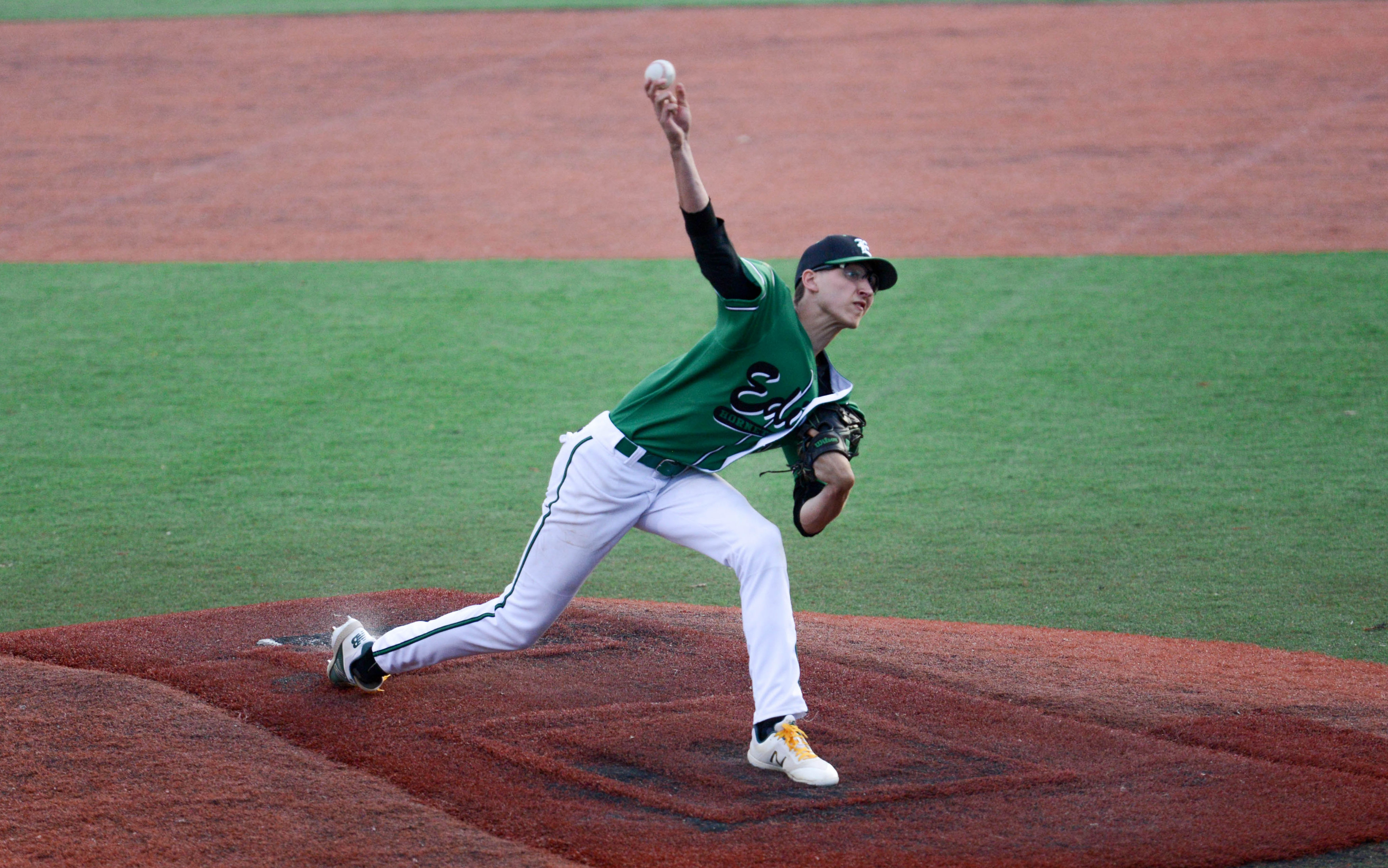Edina pitcher Will Eckland (11) releases a pitch against Minnetonka. Eckland struck out 10 batters in 6 2/3 innings. The Hornets beat the Skippers 5-3. Photo by Carter Jones, SportsEngine
