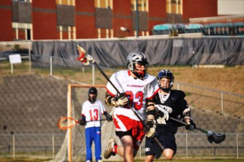 men's lacrosse player outruns opponent