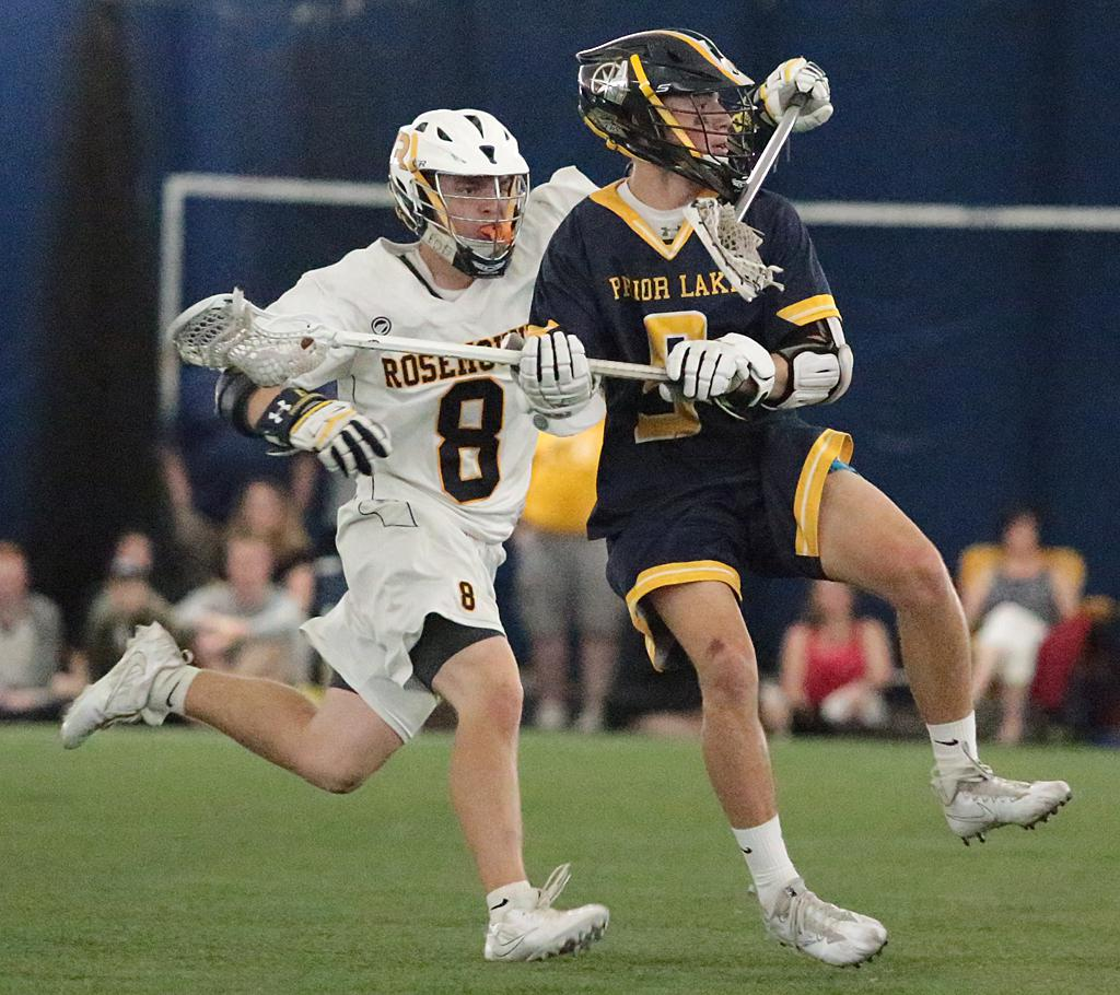 Senior defender Jackson Hahn (8) wraps up attackman Benjamin Jung (9) at midfield. Hahn and the rest of the Rosemount defenders shut down Prior Lake's offense in a 6-3 win on Thursday night. Photo by Cheryl Myers, SportsEngine