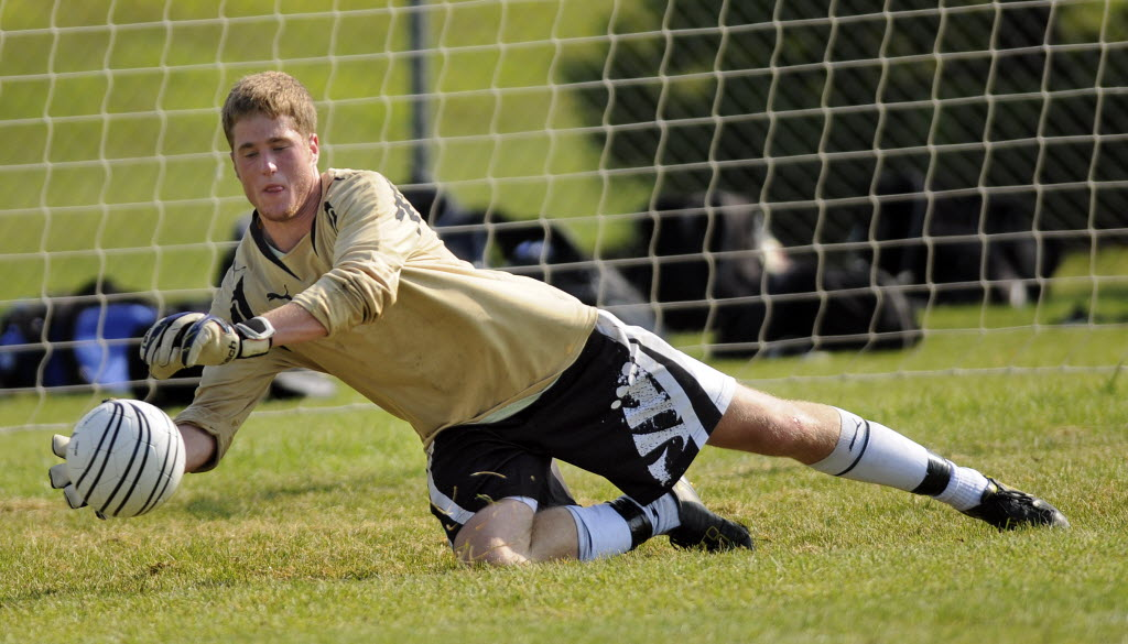 Apple Valley starting goalie senior Josh Rosenthal blocks a shot during practice Aug. 23. Richard Sennott, Star Tribune