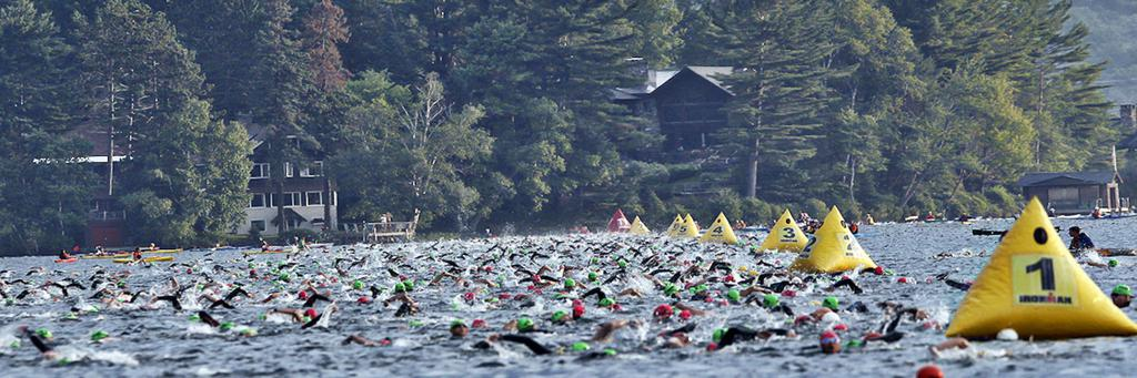 A crowd of swimmers off to the races at IRONMAN Lake Placid