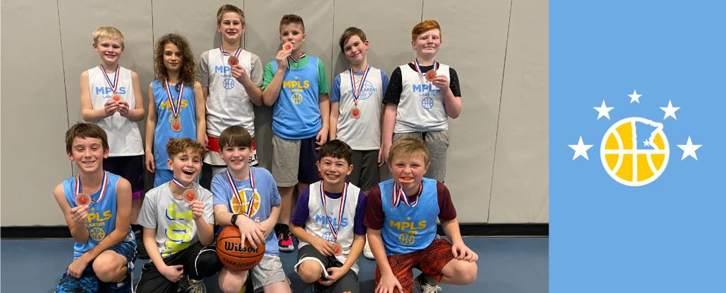 Minneapolis Lakers 6th Grade Blue pose with their medals after earning 3rd place at the Bloomington Lions Invitational tournament in Bloomington, MN